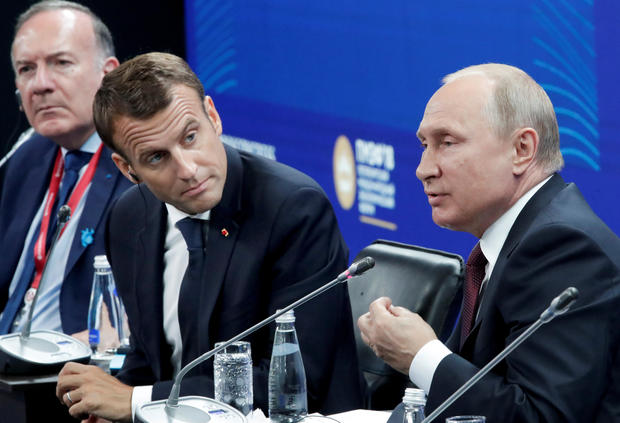 Russian President Putin and his French counterpart Macron attend a session of the St. Petersburg International Economic Forum