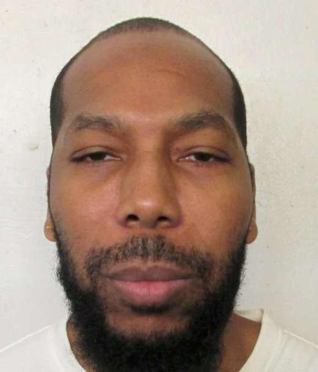 42岁的死囚犯Dominique Ray出现在阿拉巴马州蒙哥马利的预订照片中