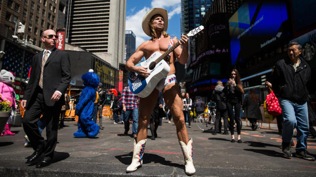 The Naked Cowboy plays guitar in Times Square on April 9, 2014, in New York City.