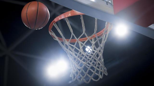 Basketball reaching to hoop