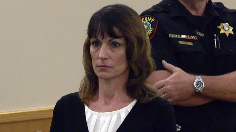 Michele Williams stands to hear the jury's verdict