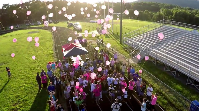 Balloons are released in memory of Alexis Murphy