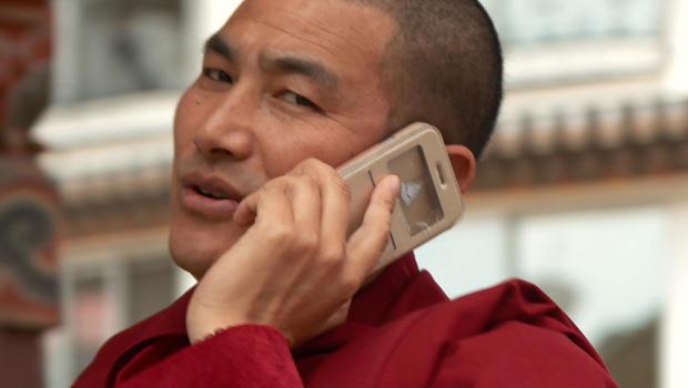 bhutan-bhutanese-man-on-cell-phone-620.jpg