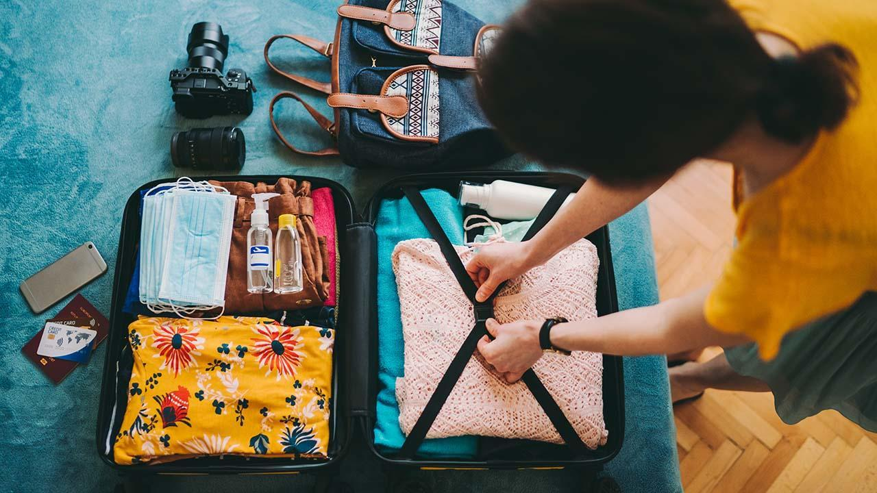 Woman packing suitcase for travel