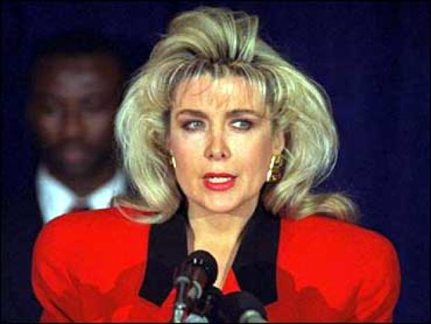 Gennifer Flowers speaks to the press about her claim of a 12-year affair with then-Democratic presidential hopeful Bill Clinton during a news conference in New York Jan. 27, 1992.