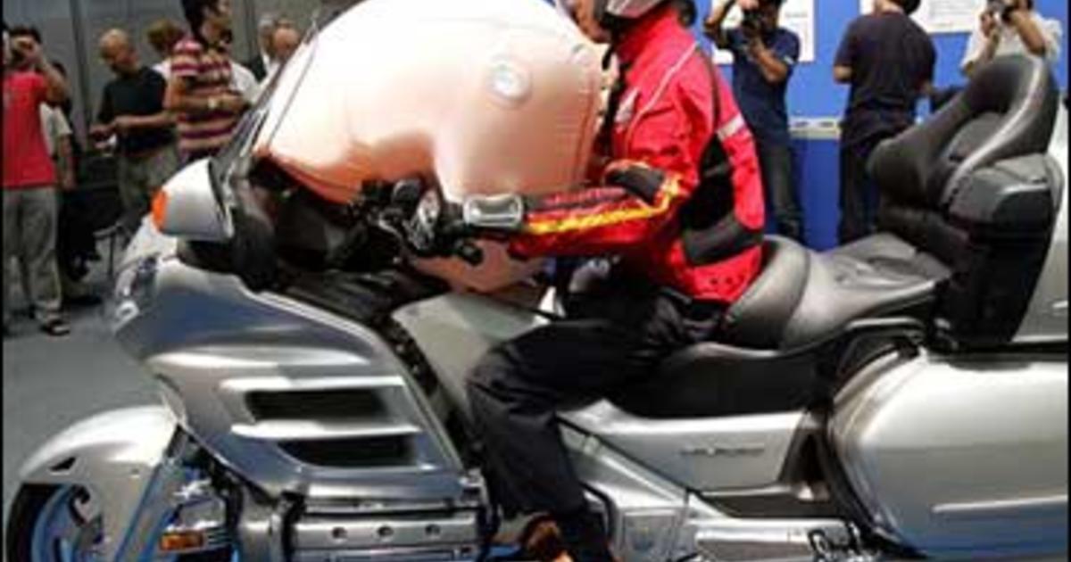 honda makes motorcycle airbag - cbs news