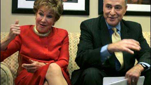 """Sens. Elizabeth Dole, R-N.C., left and Charles Schumer, D-N.Y., talk before appearing on CBS's """"Face the Nation"""" in Washington, Sunday, Oct. 22, 2006."""