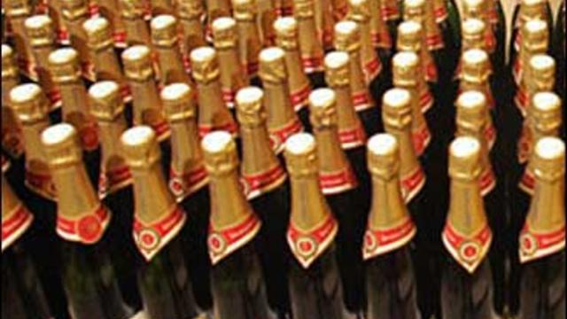 Champagne bottles line the shelves of a supermarket in the northern city of Bailleul, France, Feb. 15, 2012.