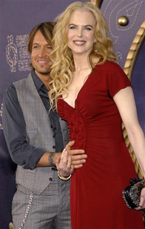 Country Stars On The Purple Carpet