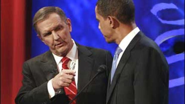 Sen. Barack Obama, D-Ill. listens to ABC News moderator Charles Gibson