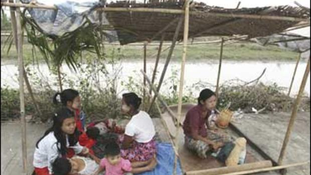 Myanmar family, who survived last week's destructive cyclone Nargis, stay in a temporary shelter in the outskirts of Yangon