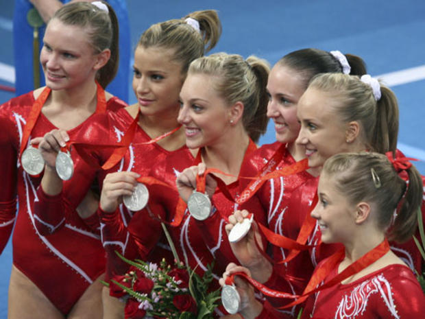 From left, U.S. gymnasts Bridget Sloan, Alicia Sacramone, Samantha Peszek, Chellsie Memmel, Nastia Liukin and Shawn Johnson display their silver medals after the women's gymnastics team finals at the Beijing Olympics on August 13, 2008. The Americans came in second place to the Chinese team.