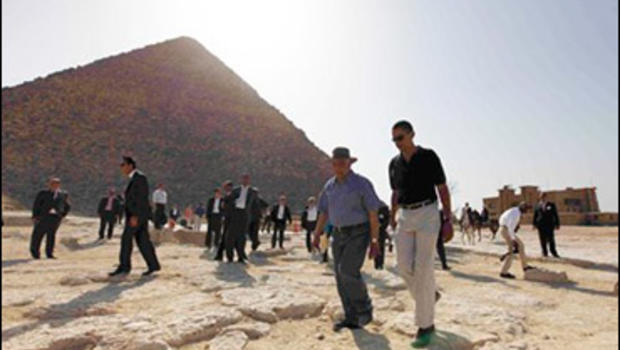 U.S. President Barack Obama, right, is escorted on a tour of the pyramids near Cairo, Thursday, June 4, 2009.