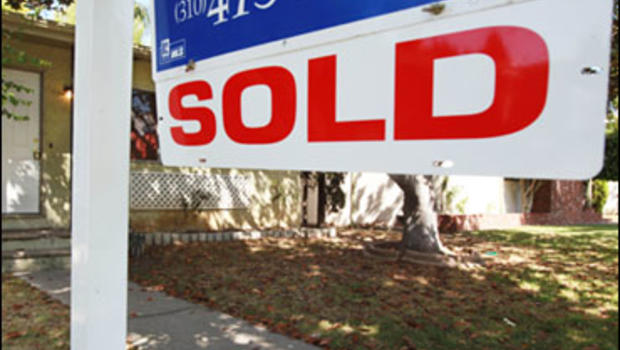 """In this June 23, 2009 photo, a """"sold"""" sign is seen on a home for sale in Los Angeles. A real estate group's report says sales of previously occupied homes rose 3.6 percent from May to June, the third consecutive monthly increase and a sign that a housing"""