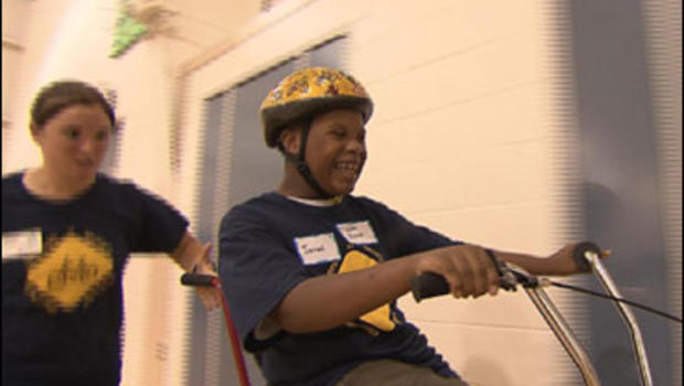 Children with autism and Down's Syndrome learn how to ride a bicycle at a camp run by researchers at the University of Michigan.