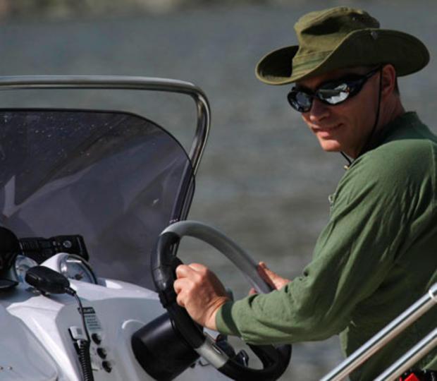 Vladimir Putin drives a boat