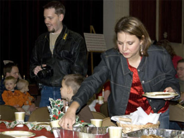 Susan Powell, right, at a church function with her husband Josh Powell, left, Dec. 5, 2009