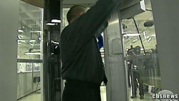 Passenger gets a full body image scan.