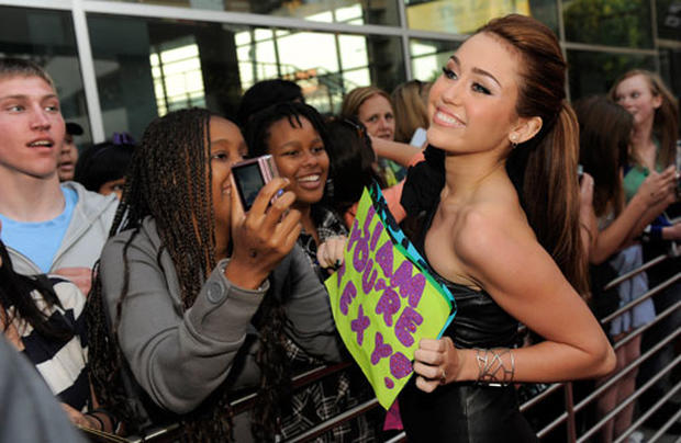 Miley Cyrus Signing Autographs