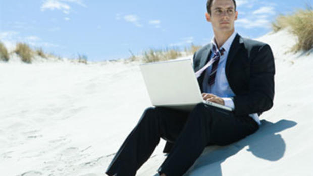 On the beach, but not away from work.