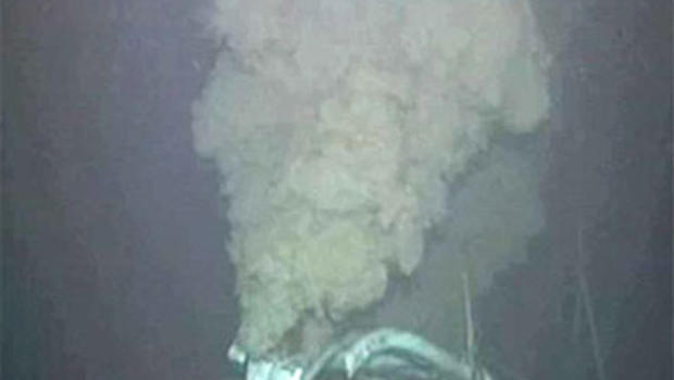 An underwater camera captures a plume of oil during operations to cut the broken riser pipe at the site of the Deepwater Horizon drilling rig in the Gulf of Mexico, Tuesday, June 1, 2010.