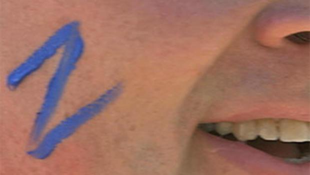 A Z adorns the cheek of a Zappos employee.
