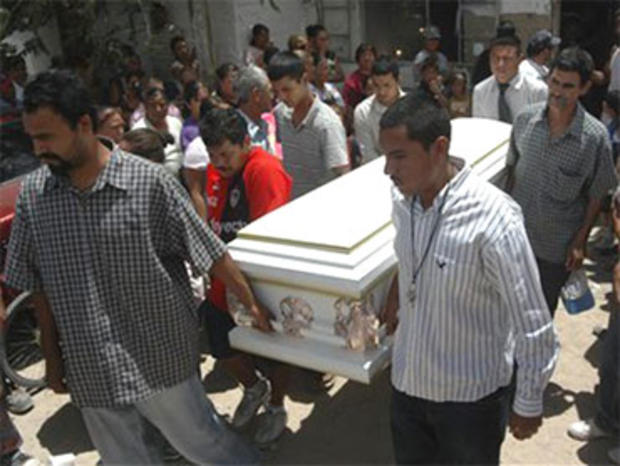 Friends and relatives of Sergio Adrian Hernandez Huereka, 15, carry his coffin before his burial in the northern border city of Ciudad Juarez, Mexico, Thursday June 10, 2010. A U.S. Border Patrol agent fatally shot Hernandez Monday after a group trying to