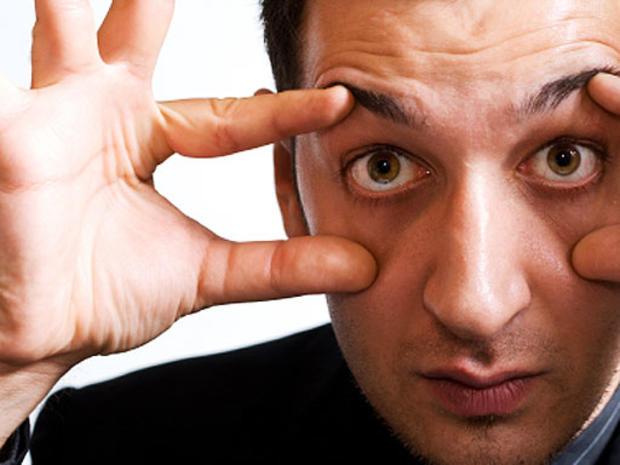 man-holding-eyes-open.jpg