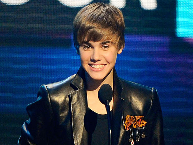 Justin Bieber accepts the award for pop/rock favorite male artist at the 38th Annual American Music Awards on Sunday, Nov. 21, 2010, in Los Angeles.