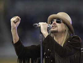 Musician Kid Rock performs during the half time ceremony at the NFL football game between thd Detroit Lions and the New England Patriots, Thursday, Nov. 25, 2010, at Ford Field in Detroit. (AP Photo/Carlos Osorio)