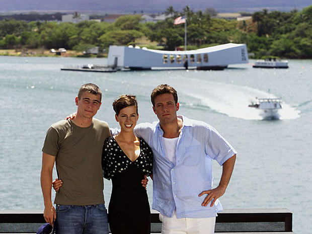 From left, Josh Hartnett, Kate Beckinsale, and Ben Affleck gather together on the flight deck of the aircraft carrier USS John C. Stennis Sunday, May 20, 2001, in preparation for the World Premiere of Touchstone Pictures' / Jerry Bruckheimer Films' PEARL HARBOR. Pictured in the background is the USS Arizona Memorial located in Pearl Harbor, Hawaii. (photo by Kevin Winter/Touchstone Pictures/Getty Images