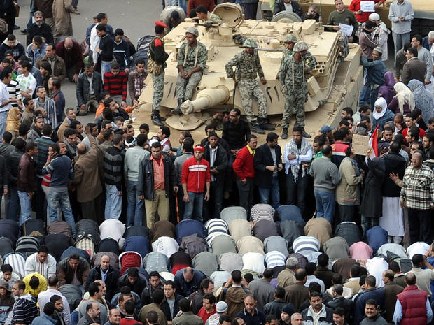 Protesters, Egyptian troops in Tahir Square.