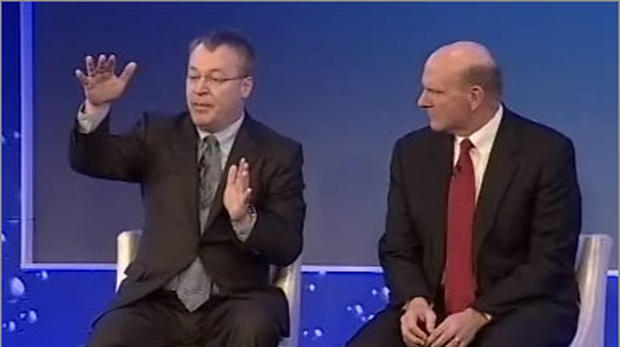 Nokia CEO Stephen Elop, let, and Microsoft CEO Steve Ballmer explained their company's new tight alliance for mobile phones at an analyst and strategy meeting in London.