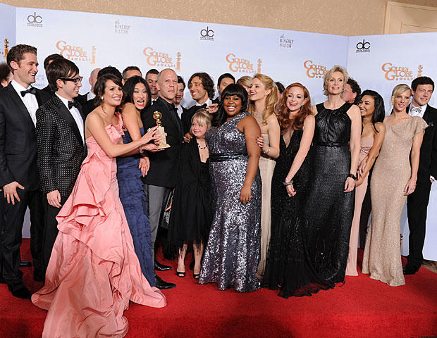 """he cast and crew of """"Glee,"""" pose with the award they won at the Golden Globe Awards on Jan. 16, 2011. (GETTY Images)"""