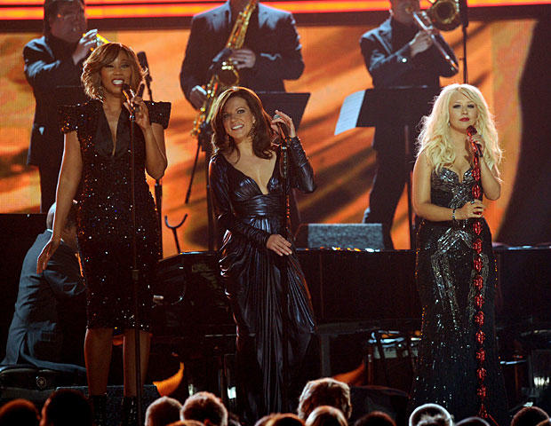 Singers Yolanda Adams, Martina McBride and Christina Aguilera perform a tribute to Aretha Franklin during The 53rd Annual GRAMMY Awards on Feb. 13, 2011, in Los Angeles. (Photo by Kevin Winter/Getty Images)