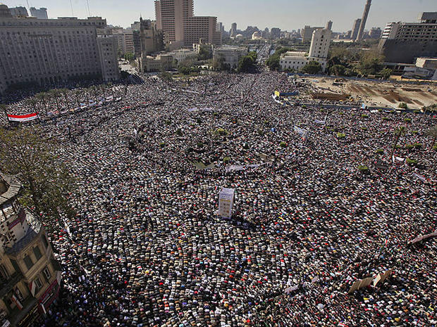 Tens of thousands of Egyptians pray and celebrate the fall of the regime of former President Hosni Mubarak