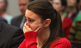Casey Anthony, 24, cries as her mother, Cindy Anthony, takes the witness stand in a courtroom in Orlando, Fla. on Wednesday, March 2, 2011