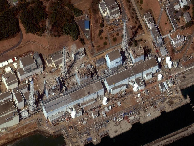 Fukushima Dai-ichi nuclear plant, March 18, 2011, with damaged reactors clearly visible.