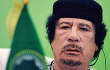 If Qaddafi stays, is military intervention failure or success?