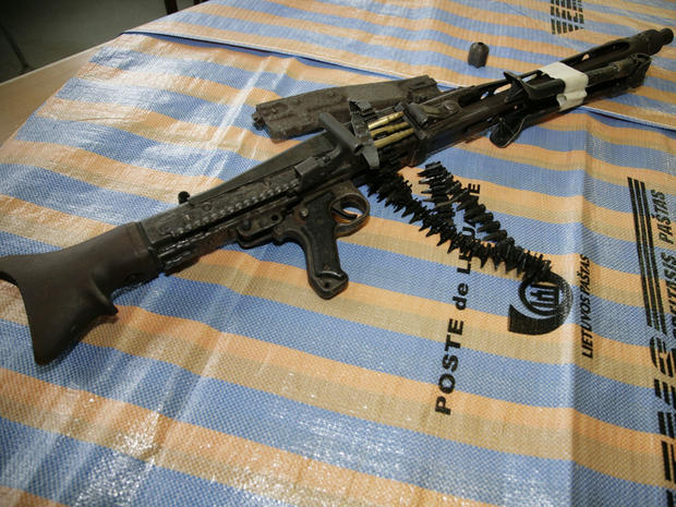 This handout photo provided by Vilnius Territorial Customs Office shows a German machine gun dating back from World War II, complete with ammunition that was found at the airport of Lithuanian capital Vilnius Tuesday, March 22, 2011. Lithuanian officials said they found the weapon in a suspicious package posted in Lithuania and bound for Germany. (AP Photo/Vilnius Territorial Customs Office )