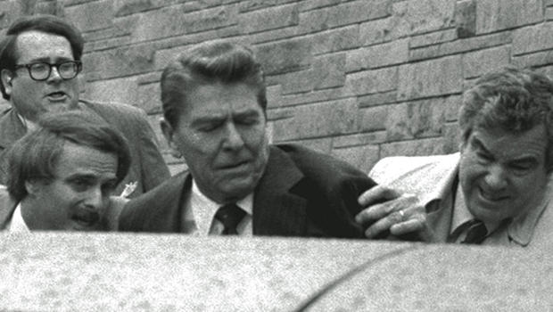 President Ronald Reagan is shoved into the presidential limousine by Secret Service agents after being shot outside a Washington hotel March 30, 1981.