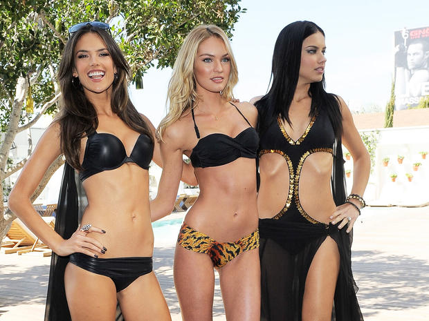 Left to right, Alessandra Ambrosio, Candice Swanepoel and Adriana Lima on March 30, 2011, in Los Angeles.