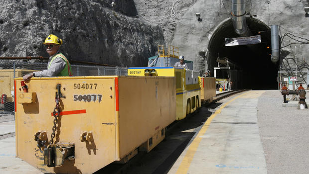 In this April 13, 2006 file photo, Pete Vavricka conducts an underground train from the entrance of Yucca Mountain in Nevada