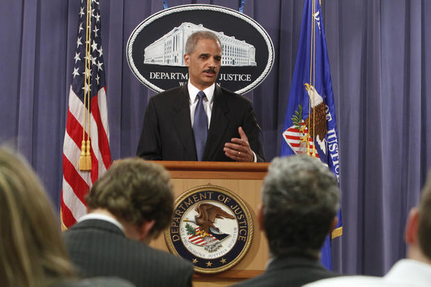 Attorney General Eric Holder gestures during a news conference at the Justice Department in Washington, Monday, April 4, 2011