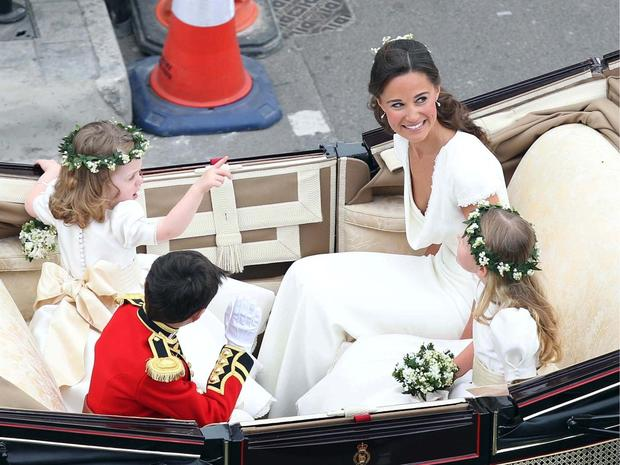 LONDON, ENGLAND - APRIL 29: Maid of Honour Pippa Middleton with brides maids and page boy make the journey by carriage procession to Buckingham Palace following their marriage at Westminster Abbey on April 29, 2011 in London, England. The marriage of the