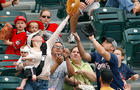 Tiffany Goodwin catches a foul ball in front of her husband