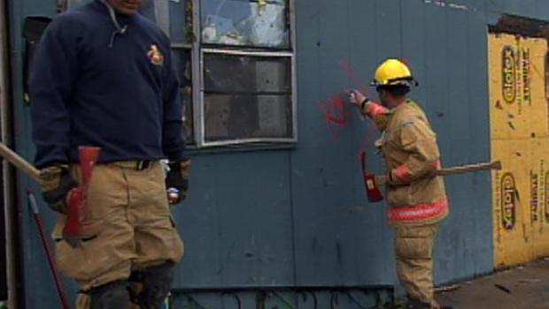 Search and rescue teams go door-to-door in Joplin, Mo.