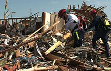 Rescue teams search for missing in Joplin, Mo.