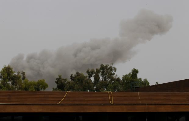 Smoke rises over Tripoli after a NATO airstrike