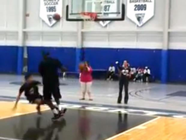 LeBron James dunking on kid